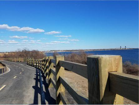 High protective fence along scenic view of Jamaica Bay
